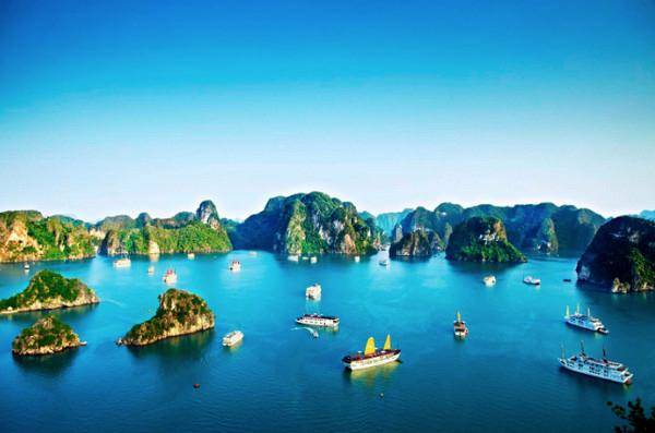 Halong-Bay-with-its-karst-towers-and-misty-early-morning-appearance-is-unforgettable-in-Vietnam-tours-with-beach